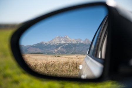 Car rear view of high mountains
