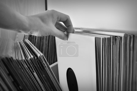 Photo for Crate digging through vinyl records music collection. Black and white. - Royalty Free Image