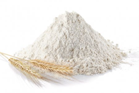 Heap of wheat flour and wheat ears on isolated whi...