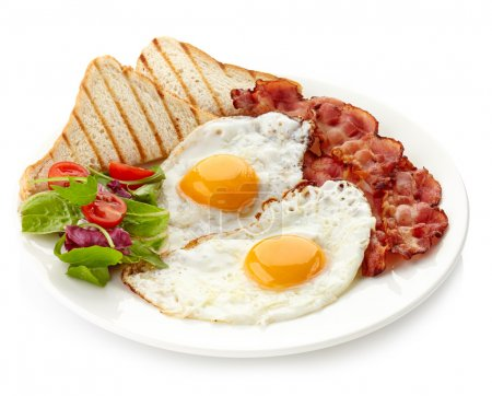 Photo for Plate of breakfast with fried eggs, bacon and toasts - Royalty Free Image