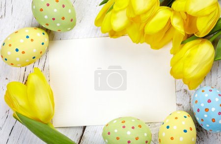 Photo for Colorful Easter eggs, tulips and blank card on wooden background - Royalty Free Image