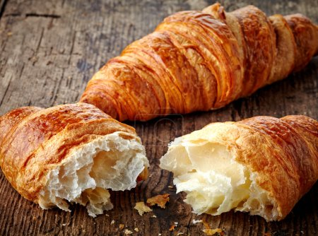 Photo for Fresh croissants on wooden background - Royalty Free Image