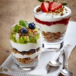 Healthy layered cream desserts with fresh berries ...
