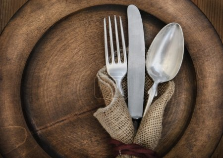 Photo for Vintage silverware on rustick wooden plate - Royalty Free Image
