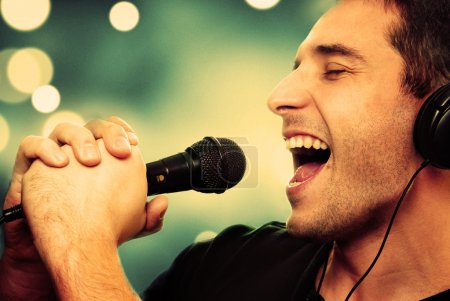 Retro image of man singing into microphone...