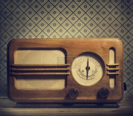 Antique radio on retro background...