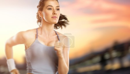 Photo for Girl in sport on the sunset background - Royalty Free Image