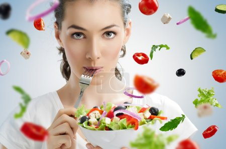 A beautiful girl eating healthy food...