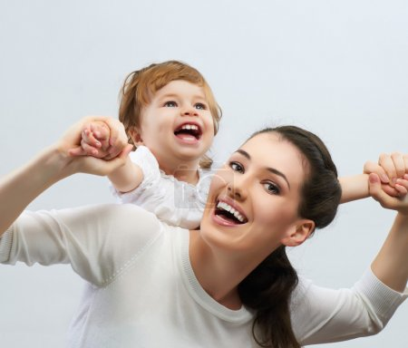 Photo for Happy mother holding her baby - Royalty Free Image