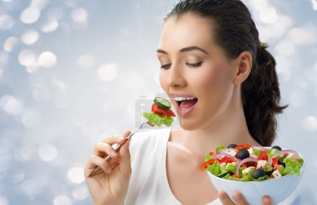 Photo for A beautiful girl eating healthy food - Royalty Free Image