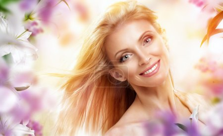 Photo for Beauty woman on the flower background - Royalty Free Image