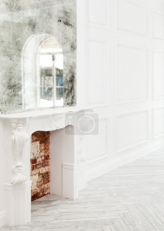 Fireplace in white room