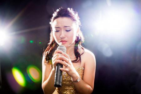 Photo for Concert young Asian singer of the girl - Royalty Free Image