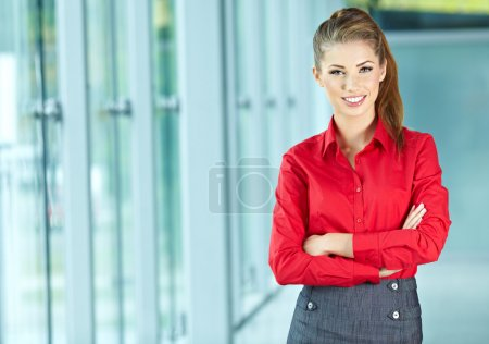 Photo for Portrait of happy smiling young businesswoman in office - Royalty Free Image