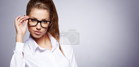 Photo for Eyewear glasses woman closeup portrait. Woman wearing glasses holding frame in close-up. - Royalty Free Image