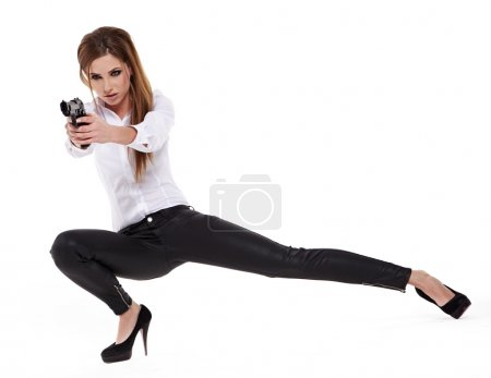 young beauty woman holding handgun