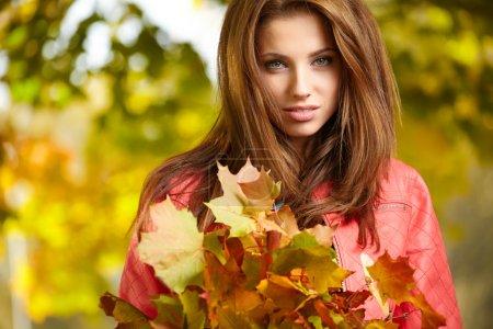 Beautiful autumn woman in golden