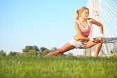 Woman stretching hamstring leg muscles