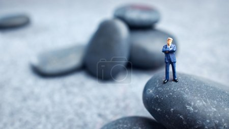 Photo for Business miniature figures and rocks - Royalty Free Image