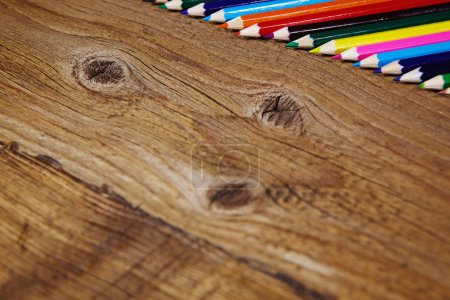 Set of color pencils on old wooden
