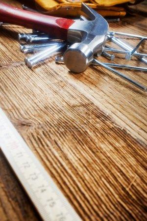 Hammer, nails, ruler on wood