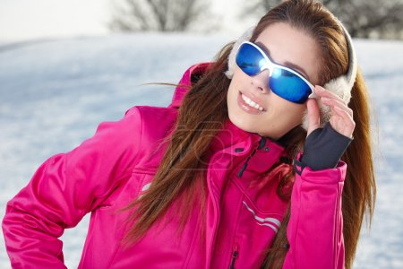 Happy smiling woman in ski goggles