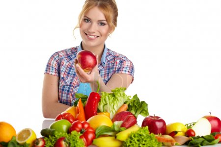 Woman with lot of fruits and vegetables