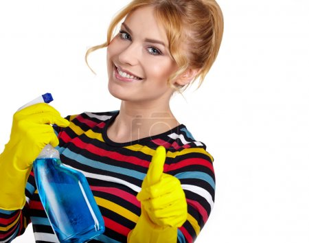 Woman as a cleaning maid holding liquids and showing OK sign