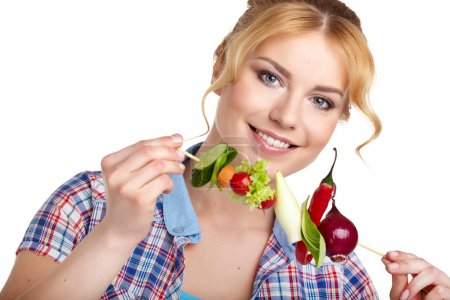 Woman holding vegetable skewers