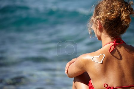 Girls back with heart of sun lotion