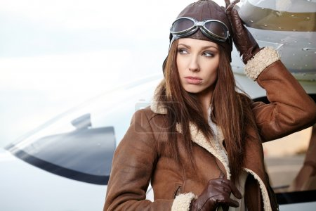 Woman pilot in front of airplane