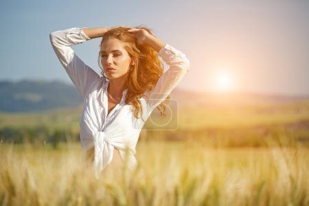 Photo for Woman in wheat field enjoying, freedom concept - Royalty Free Image