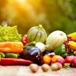Fresh organic vegetables and fruits on wood table ...
