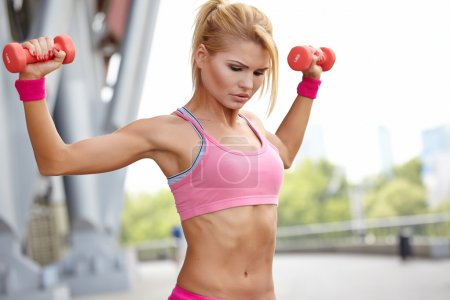 Fitness instructor exercising with weights