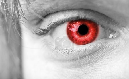Close-up photo of a red vampires eye...
