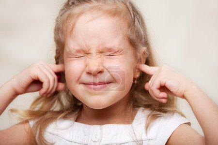 Girl covered her ears