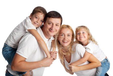 Photo pour Famille avec deux enfants sur fond blanc - image libre de droit