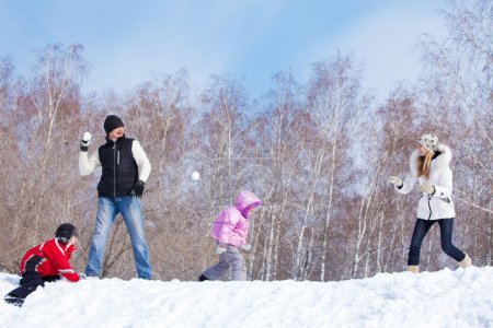 Family playing snowball