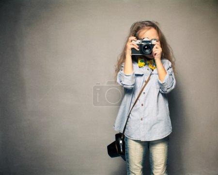 Child with camera.