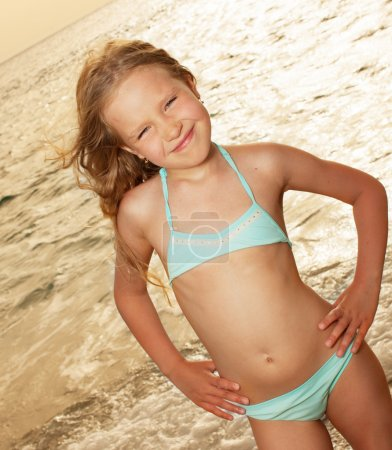Photo for Vacations. Girl on the beach. Sunset. - Royalty Free Image