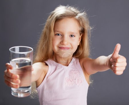 Photo for Child drinking water from glass - Royalty Free Image
