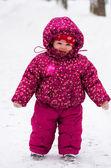 Baby walk by snow near winter park
