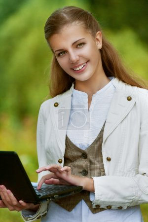 beautiful young woman with black laptop