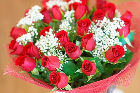 Photo for Beautiful large festive bouquet of red roses. - Royalty Free Image