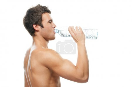 Portrait of young man drinking water