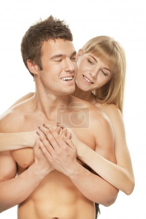 Young happy couple against white background