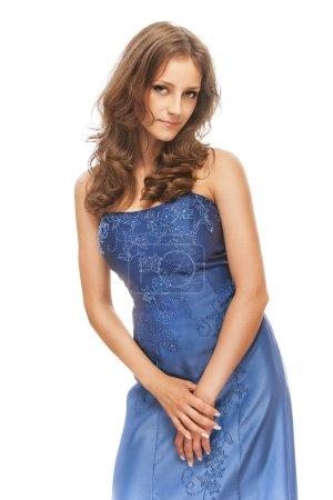 Photo pour Femme en robe bleue, sur fond blanc. - image libre de droit