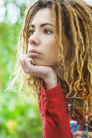 pensive woman with dreadlocks closeup