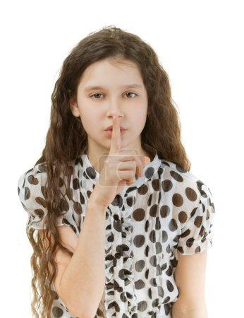 schoolgirl puts finger to lips