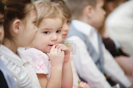 Preschool children sits in kindergarten